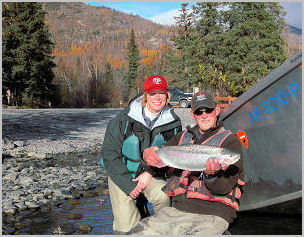 Pulling into Jim's Landing with one more Kenai River Rainbow.